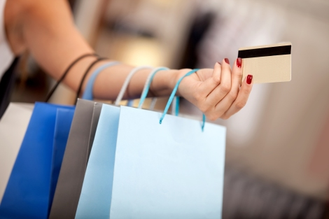 woman-with-shopping-bags-and-credit-card